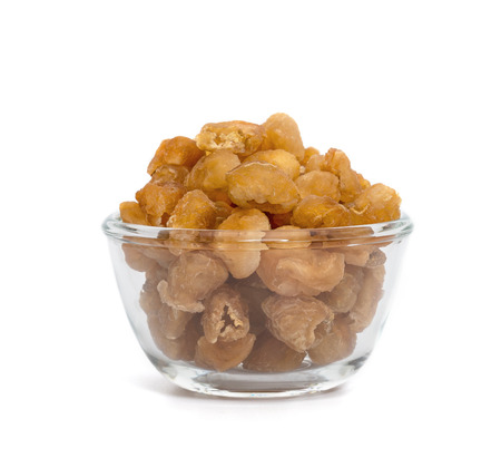 dried longan fruit in glass bowl isolated on white background