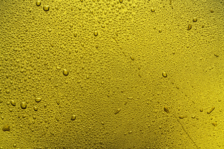 Shiny golden metal wall with droplet texture background,gold pattern