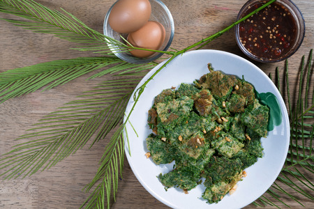 Fried Egg With Climbing Wattle or cha-om omelettes,Thai food  Stock Photo