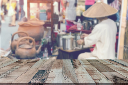 Top desk with blur ancient coffee shop in Northern of Thailand background,wooden table Stock Photo