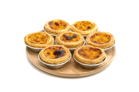 egg tart in aluminum foil cup isolated on white background Stock Photo