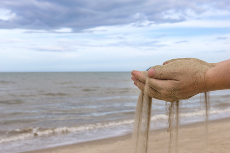 Sand in hand with sea view.