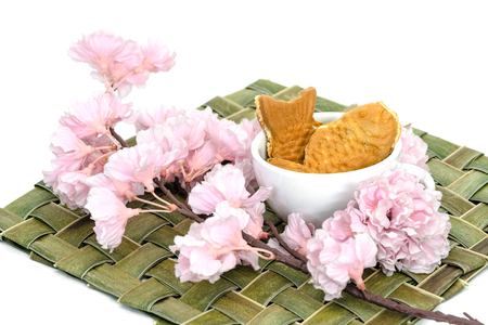 Taiyaki cakes in coffee cup with cherry blossom,Japanese confectionery
