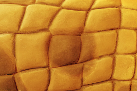 Golden stone wall construction background Stock Photo