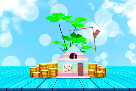 Start creating family with top table house and coin on white cloud and blue sky background,Dream family concepts