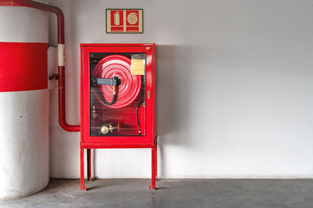 fire extinguish equipment with white wall Stok Fotoğraf