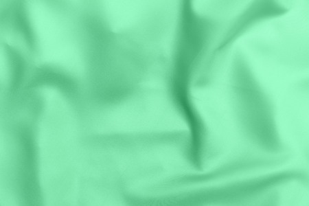 green satin fabric texture soft blur background Stock Photo