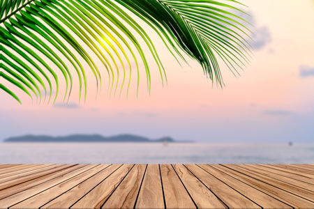 Wooden table with beach landscape blur background Stock Photo