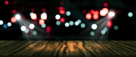 top desk with blur restaurant background,long wooden table and blurred bokeh of night street background