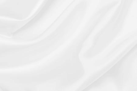 tessuto di raso bianco trama morbida sfocatura dello sfondo
