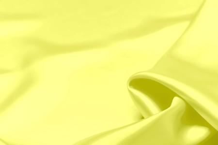 Yellow satin fabric texture soft blur background