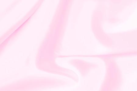 Plastic pink satin fabric texture soft blur background Stock Photo