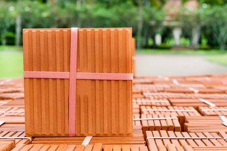 Stack of brown tiles at the constructing site Stock Photo
