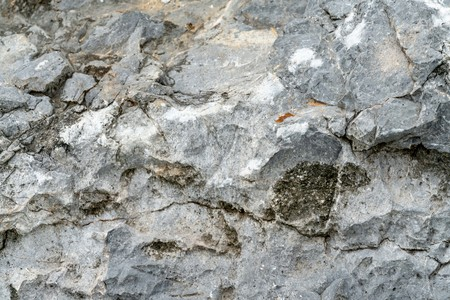 Closeup rock pattern with hole in nature