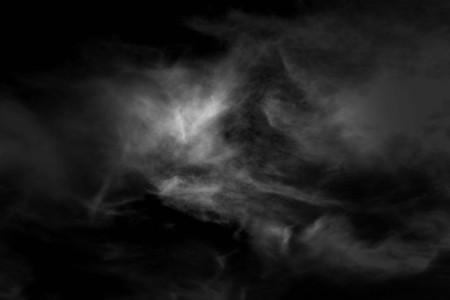 weiße Wolke und schwarzer Himmel strukturierter Hintergrund