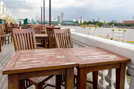 outdoor dining table set with Chao Phraya River side Stock Photo