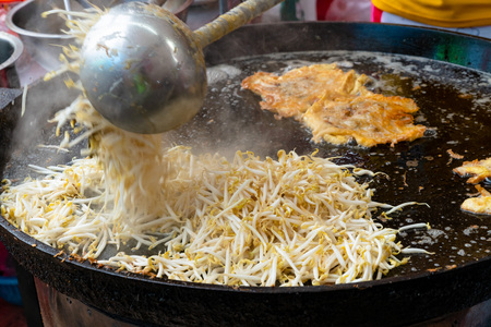 Fried bean sprouts in black pan