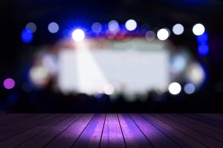 blurred concert blue lighting and bokeh on stage with wooden floor