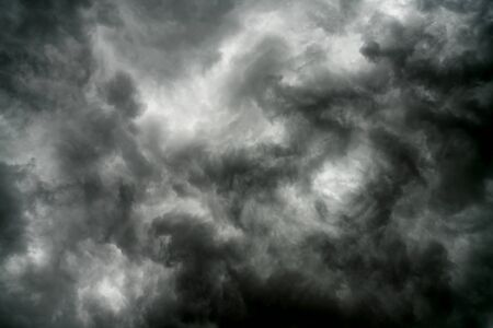 Rain clouds and black sky textured background