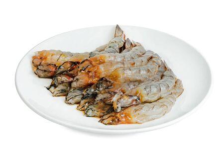 Peeled shrimp raw  with plate isolated on white background