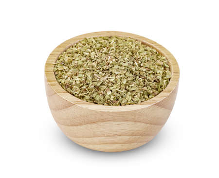 Oregano in wooden bowl isolated on white background Zdjęcie Seryjne