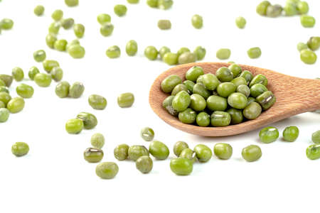 green mung beans with wooden spoon isolated on white background