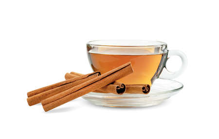 Transparent cup of tea with cinnamon sticks isolated on white background