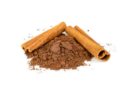 cinnamon powder and sticks isolated on a white background