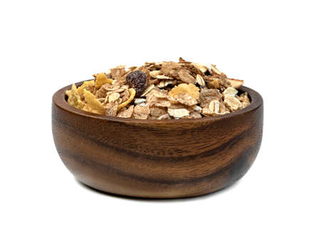 muesli multi fruit in wooden bowl isolated on white background