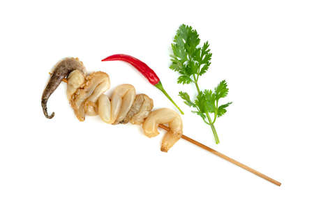 tentacles of squid with skewer isolated on white background