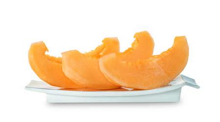 Orange cantaloupe melon fruit sliced on dish isolated on white
