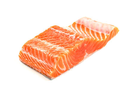 Piece of fresh salmon fillet sliced isolated on white background Foto de archivo