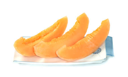 Orange cantaloupe melon fruit sliced on dish isolated on white background