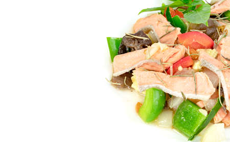 stir fried salmon and sweet bell pepper with copy space isolated on white background