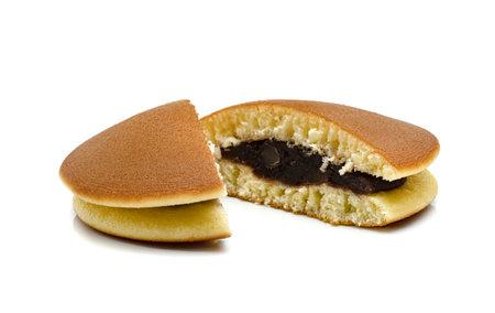 Dorayaki or japanese pancakes isolated on white background