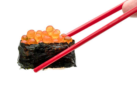 rolled sushi of salmon roe nigiri with red chopsticks isolated on white background
