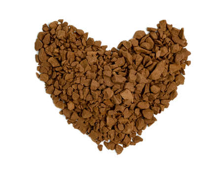 Instant coffee powder with heart shaped isolated on white background Standard-Bild