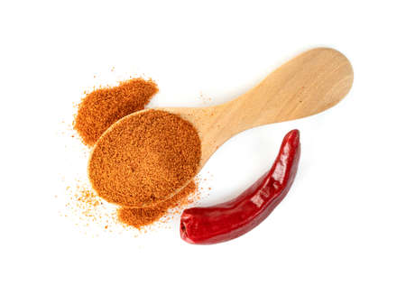 red ground paprika powdered or dry chili pepper with wooden spoon isolated on white background