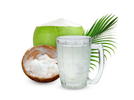 Coconut juice in glass cup with green leaves pattern isolated on white background