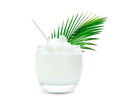 Coconut Smoothie in glass cup with green leaves pattern isolated on white background