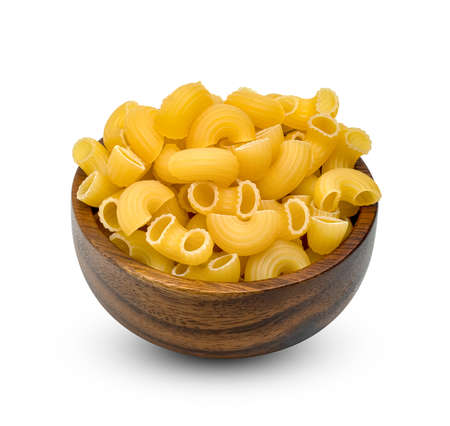 raw macaroni pasta with wooden bowl isolated on white background Stock Photo
