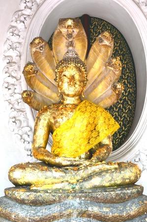 Buddha with seven-headed naga snakes, Nakhon Pathom province, Thailand photo