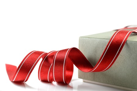 innumerable: Paper box and cloth ribbon on white background