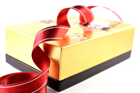 innumerable: Wooden box and cloth ribbon on white background