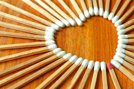 Heart shaped matchstick on wooden background photo