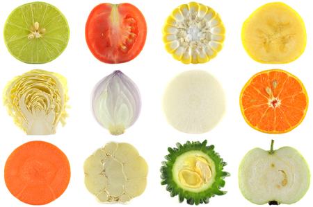 Halves of crop, fruits and vegetables on white background