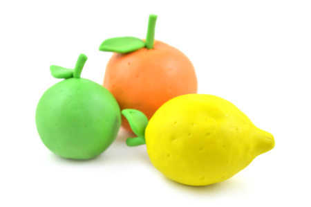 modelling clay: Modelling clay citrus fruit on white background