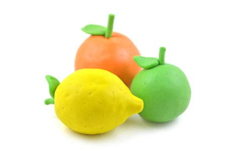 modelling: Modelling clay citrus fruit on white background