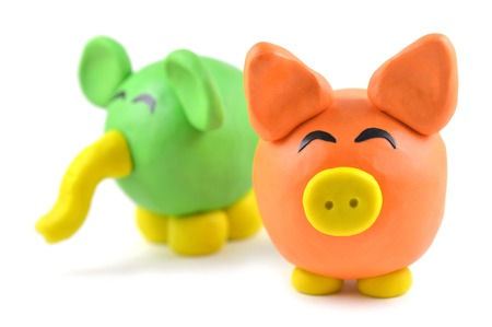 modelling clay: Modelling clay pig and elephant on white background
