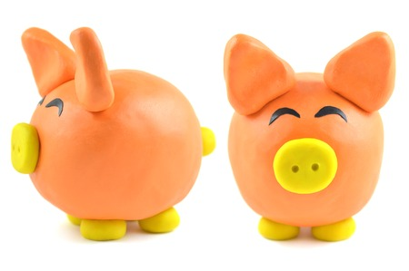 Modelling clay pig on white background